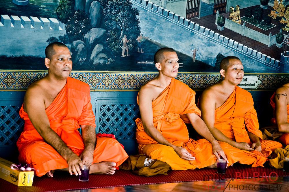 buddhist monks. Wat Phra Kaew, or Temple of the Emerald Buddha. Grand Palace. <br /> Bangkok, Thailand.