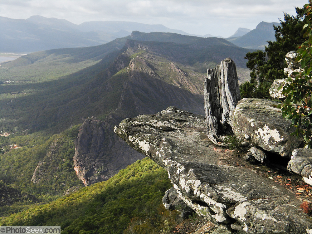 See Boroka Lookout in Grampians National Park (Gariwerd), Victoria, Australia, 235 km (3 hours drive) west of Melbourne. The Grampians have striking sandstone mountain ranges which create an ecological island full of native plants and animals. The Grampians are popular for campers, flower lovers, bird lovers, bushwalkers, and rock climbers. The ranges were named in 1836 by Surveyor General of New South Wales Sir Thomas Mitchell after the Grampian Mountains in his native Scotland. The high peaks are sandstone which was laid down from rivers during the Devonian era 380 million years ago.