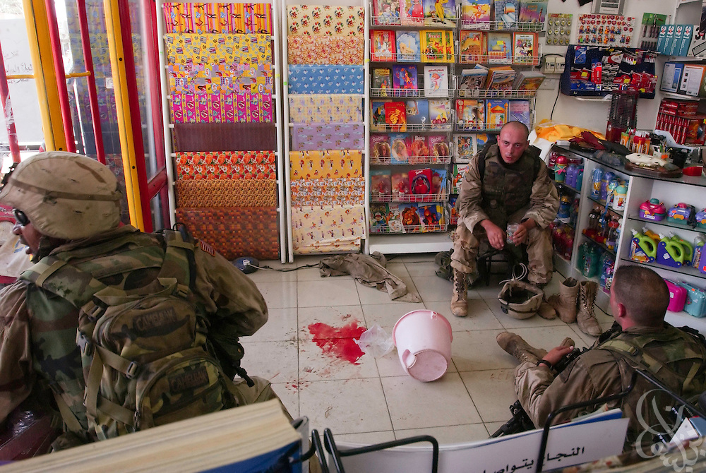 Blood stains the spot inside an Iraqi toy store where already evacuated U.S. soldiers were treated for their injuries following a nearby rocket propelled grenade (RPG) attack on American soldiers August 08, 2003 in dowtown Baghdad, Iraq.