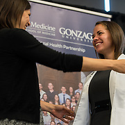 Medical students in the new UW School of Medicine-GU Regional Health Partnership take part in the white coat ceremony Sept. 2 at Hemmingson Center. (Photo by Edward Bell)