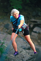 Mature woman rappelling, elevated view