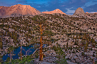 View of mountains, lake and trees in Sixty Lakes Basin, Sierra Nevada mountains of California