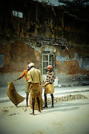 India, Kochi. Workers at ginger factory.<br /> <br /> Kochi was known for a long time as the main centrum of Indian spice trade. Although today it's only a shadow of its former glory, walking on Bazaar Road in Mattancherry still it's possible to feel its atmosphere, meet the traders of famous  specialities of Kerala, visit old Indian ginger factory  and smell the Indian spices.
