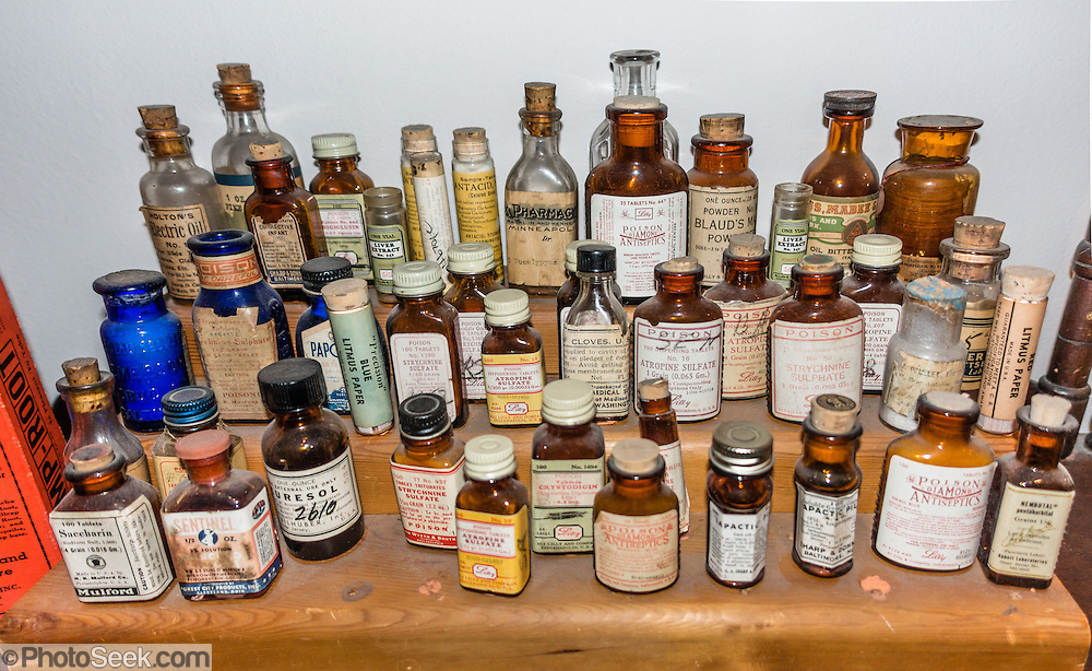 Antique pill and drug screw-top bottles and corked vials. Island County Historical Museum is at the foot of the 1905 Coupeville Wharf, in one of Washington's oldest towns -- Coupeville,  on Whidbey Island, Washington, USA. 20,000+ artifacts in the collections from Island County cover Ice Ages, early sea captains, settlers, and modern times. See Native American dugout canoes and the first automobile on Whidbey Island.