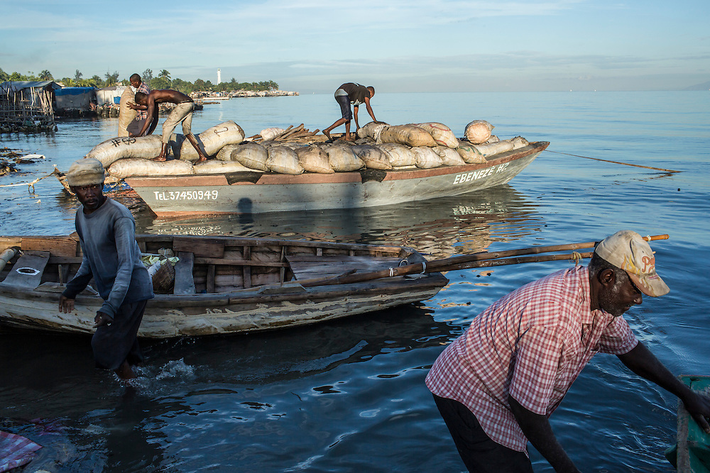 Fisherman Jean Claude Pierre, right, gets set to head out from the Carrefour area early in the morning on Monday, December 15, 2014 in Port-au-Prince, Haiti.