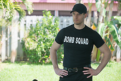 A member of The Bomb Squad in the backyard of a home in Florida