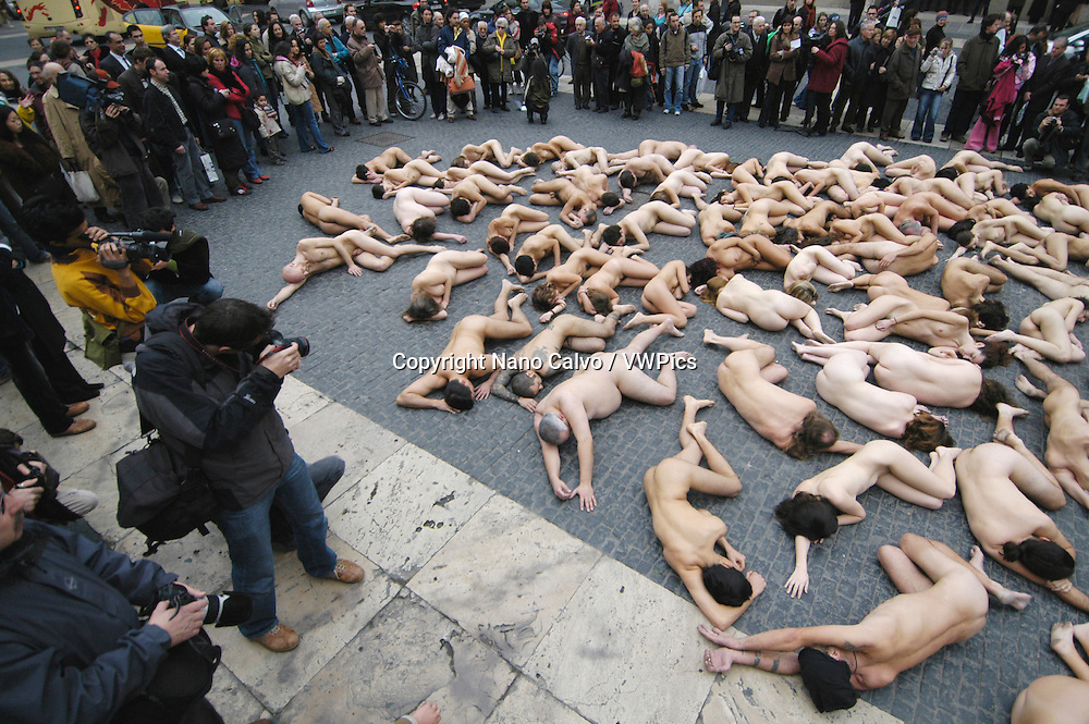 Naked activists in a public protest against use of animal fur, with the Fur is Dead and How many lives just for a coat lemas, organized by PETA - People for the Ethical Treatment of Animals - and Anima Naturalis organizations, in Barcelona, Spain