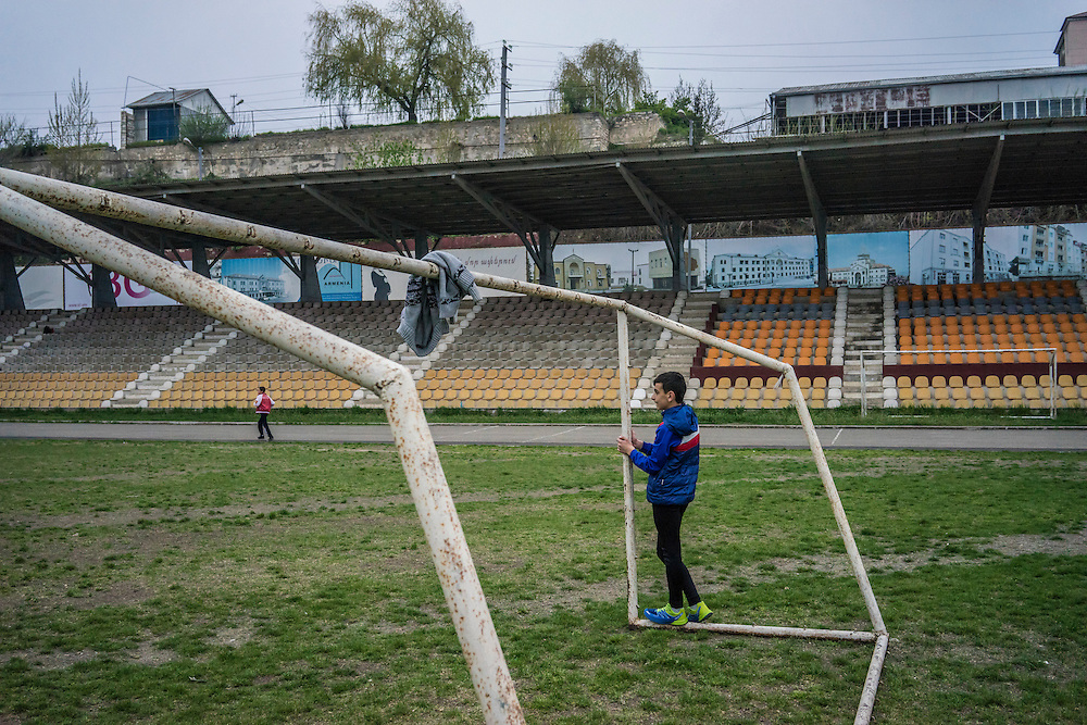 STEPANAKERT, NAGORNO-KARABAKH - APRIL 20: A boy playing soccer with friends waits by the goal he is defending on April 20, 2015 in Stepanakert, Nagorno-Karabakh. Since signing a ceasefire in a war with Azerbaijan in 1994, Nagorno-Karabakh, officially part of Azerbaijan, has functioned as a self-declared independent republic and de facto part of Armenia, with hostilities along the line of contact between Nagorno-Karabakh and Azerbaijan occasionally flaring up and causing casualties. (Photo by Brendan Hoffman/Getty Images) *** Local Caption ***