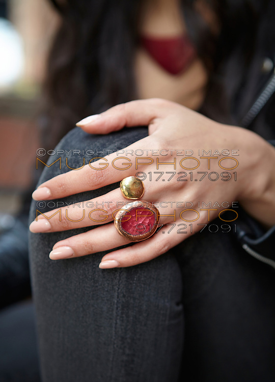 Handmade enamel jewelry by Kiln Design Studio worn by model Sona.