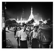 Evening rush hour in central Rangoon under the illuminated Sule Paya Pagoda, Burma.