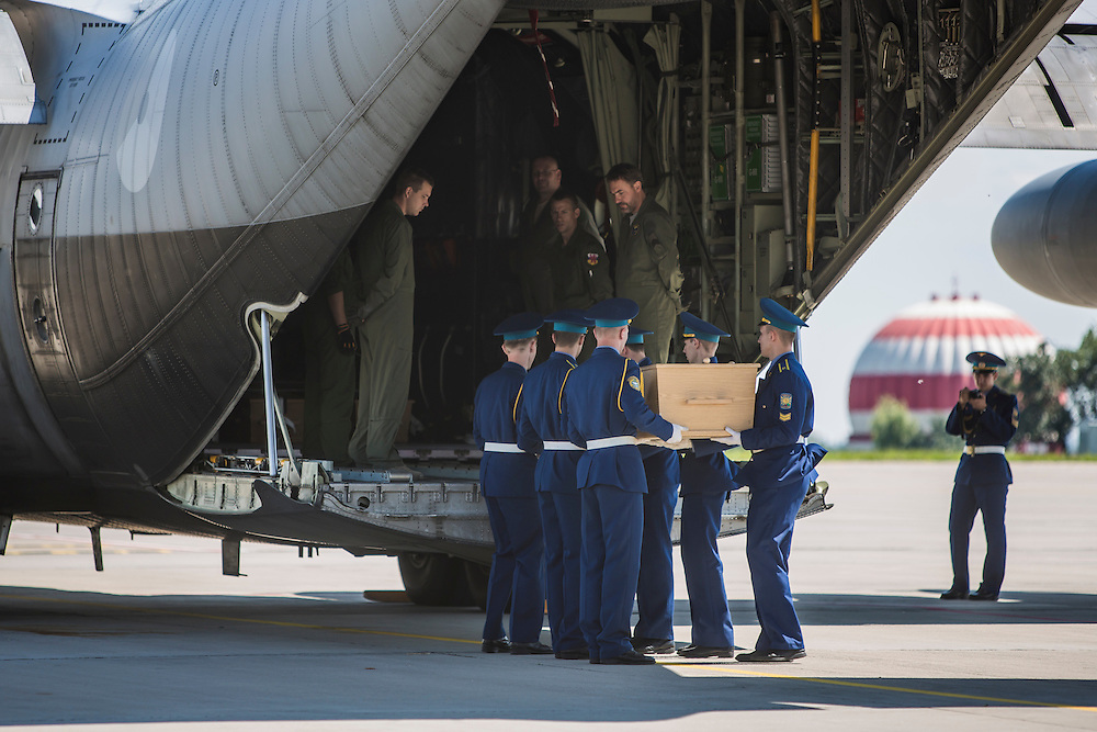 KHARKIV, UKRAINE - JULY 23: A coffin containing the body of a victim of the crash of Malaysia Airlines flight MH17 is loaded onto a plane for transport to the Netherlands during a departure ceremony on July 23, 2014 in Kharkiv, Ukraine. Malaysia Airlines flight MH17 was travelling from Amsterdam to Kuala Lumpur when it crashed killing all 298 on board including 80 children. The aircraft was allegedly shot down by a missile and investigations continue over the perpetrators of the attack. (Photo by Brendan Hoffman/Getty Images) *** Local Caption ***