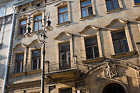 sunshine falls across attractive old facade and street lamp in krakow old town poland