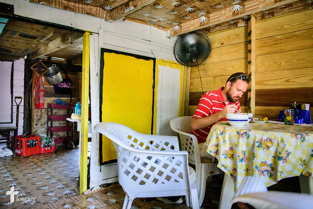 The Rev. Duane Meissner, career missionary to Belize, dines on a traditional Garifuna dish -- coconut soup with fish and pig tail and a side of smashed plantains, in the village of Seine Bight, Belize, on Wednesday, Sept. 28, 2016. The Garinagu people make up the Garifuna culture in the tiny peninsula village.  LCMS Communications/Erik M. Lunsford