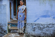 A woman outside her house in Kariakudi, Tamil Nadu, India