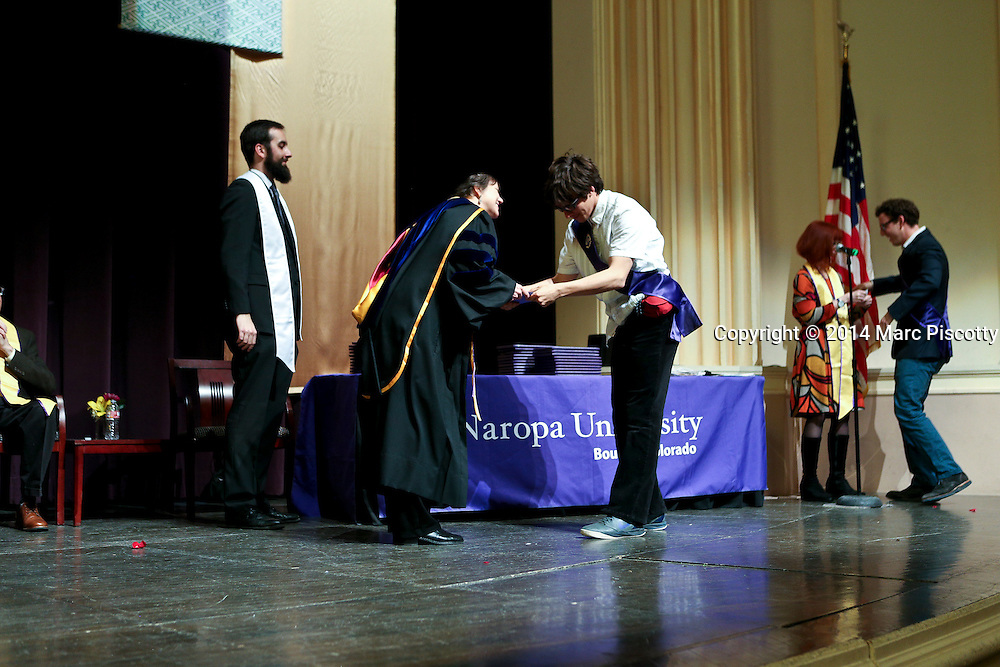 SHOT 5/10/15 3:52:18 PM - Naropa University Spring 2015 Commencement ceremonies at Macky Auditorium in Boulder, Co. Sunday. Parker J. Palmer, a world-renowned author and activist known for his work in education and social change, delivered the commencement speech to more than 300 graduate and undergraduate students along with Naropa faculty and graduate's family members. Naropa University is a private liberal arts college in Boulder, Colorado founded in 1974 by Tibetan Buddhist teacher and Oxford University scholar Chögyam Trungpa. (Photo by Marc Piscotty / © 2014)