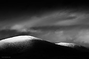Available in signed, numbered editions of 3 x A1 and 5 x A2 on 200 year archival fine-art rag papers...Second snows on the Welsh hills, and a dusted icing across the rounded summit of Moel Eilo, as seem from Anglesey.