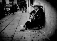 Handicapped guitar player near the Zocalo in Oaxaca City, Oaxaca, Mexico.