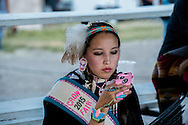Crow Fair, Crow Indian Reservation, Montana, woman with mobile phone, Narissa Fayy Reed