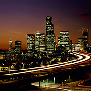AA00566-01...WASHINGTON - A 1988 image of the Seattle skyline and Interstate 5 at sunset.