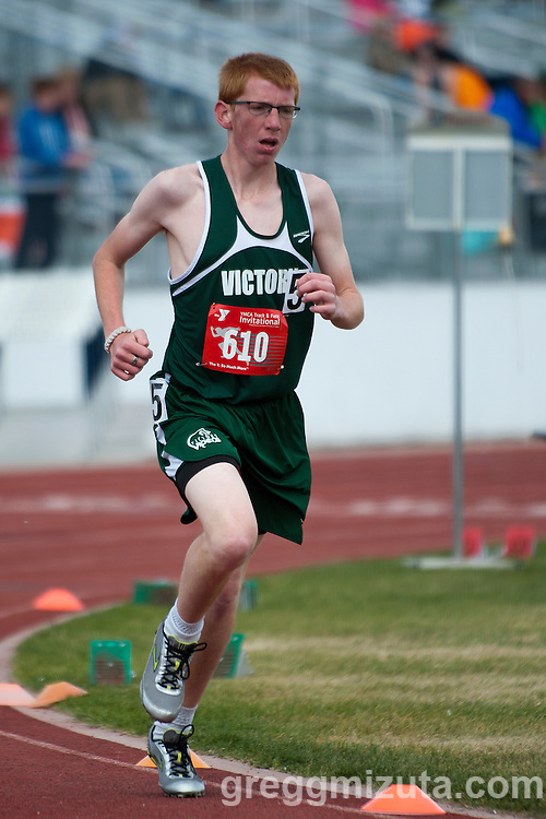 Victory Charter sophomore Keven Steele competes in the YMCA Track & Field Invitational Open 3200 meter run at Mountain View High School, Meridian, Idaho. April 25, 2015. Steele finished third in the Open division with a time of 11:15.66.