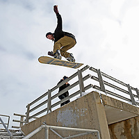 (Boston, MA - 2/10/15) Justin Fronius of Boston jumps off a pedestrian overpass on his snowboard along Morrissey Boulevard, Tuesday, February 10, 2015. Staff photo by Angela Rowlings.