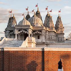 A Hindu woman arrives at The BAPS Shri Swaminarayan Mandir, also referred to as Neasden Temple, before the celebrations of Swaminarayan Jayanti at Neasden Temple in London.