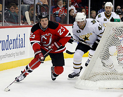 November 28, 2007; Newark, NJ, USA; New Jersey Devils right wing David Clarkson (23) skates around the goal, while being pursued by Dallas Stars defenseman Philippe Boucher (43) and Dallas Stars defenseman Sergei Zubov (56) during the second period at the Prudential Center in Newark, NJ.   Clarkson scored the Devils first goal on the play.