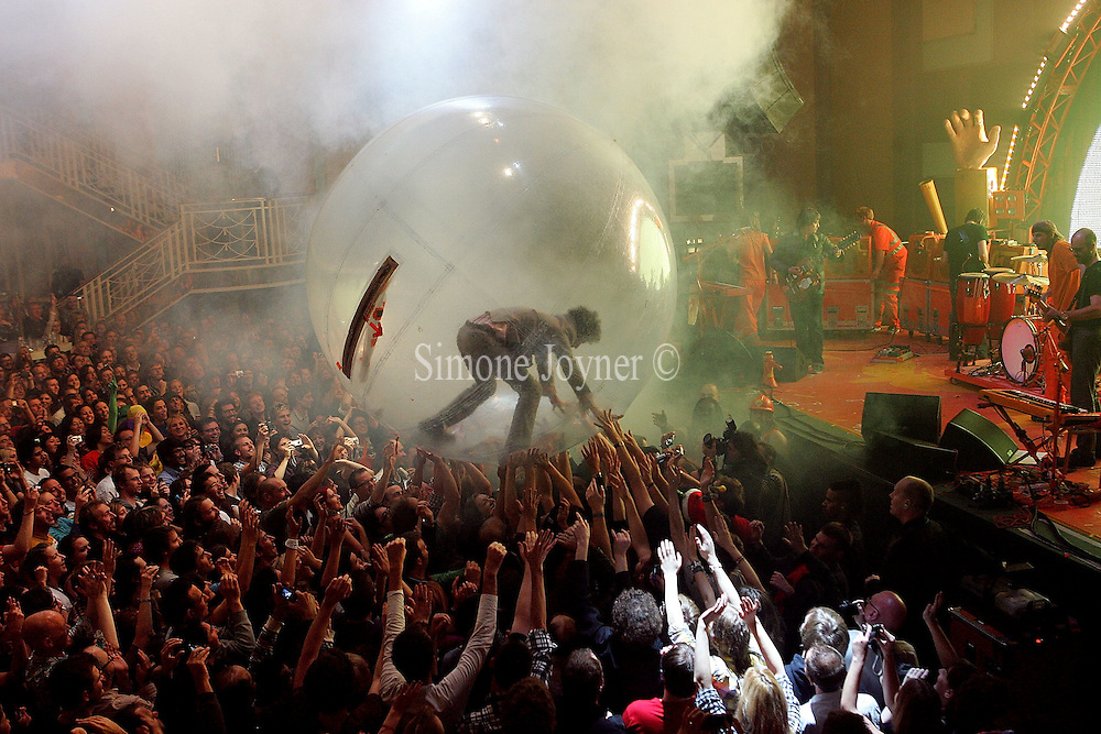 Wayne Coyne of The Flaming Lips surfs the crowd in his 'space ball' at the Troxy on November 10, 2009 in London, England.  (Photo by Simone Joyner)