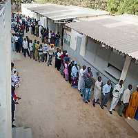 Senegalese electors queue for voting in the presidential elections at a polling station in a Franco-Arab School in Point E area of Dakar..Hundreds of people, queueing for voting since the early hours, insulted and heckled the president and candidate Abdoulaye Wade during his vote casting at the poll station, accusing the head of state of disrespect for the country's constitution when running for a third term in office..Tensions between opposition supporters and security forces have been high in the capital Dakar and other cities around the country since Wade announce his candidature late July. Some violent clashes culminated with the death of 12 people and many injured in the past month alone. ©Sylvain Cherkaoui