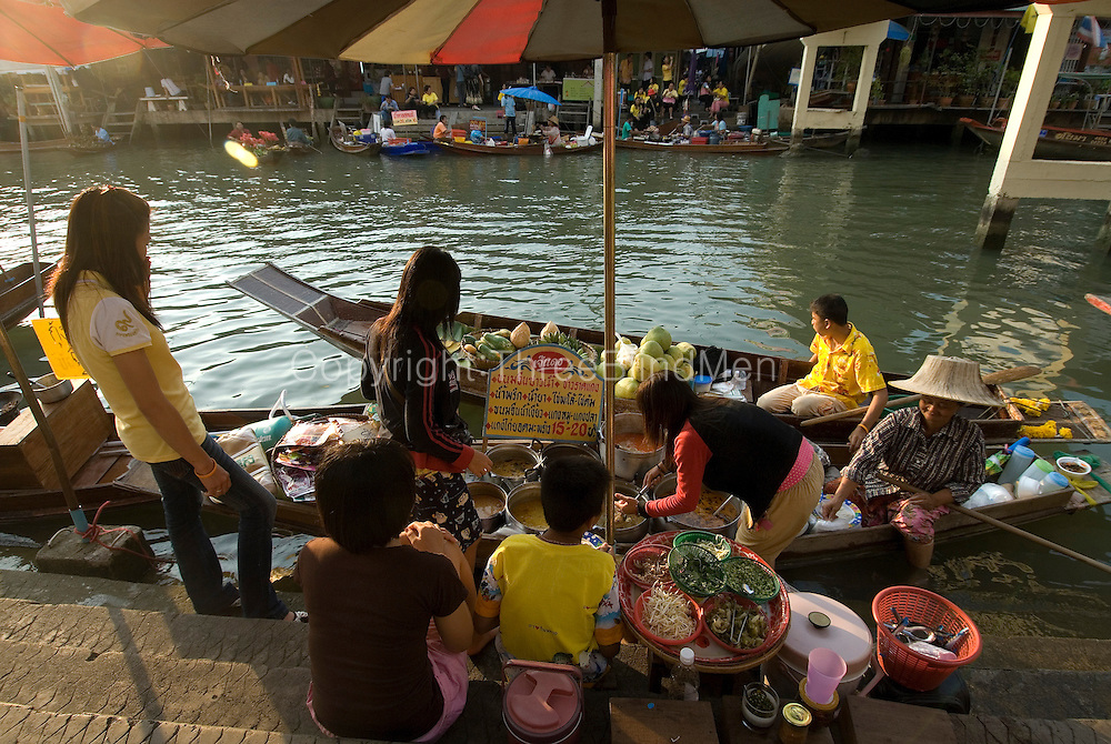 Family working on their food stall at Ampawa floating market. Samuthsongkram province