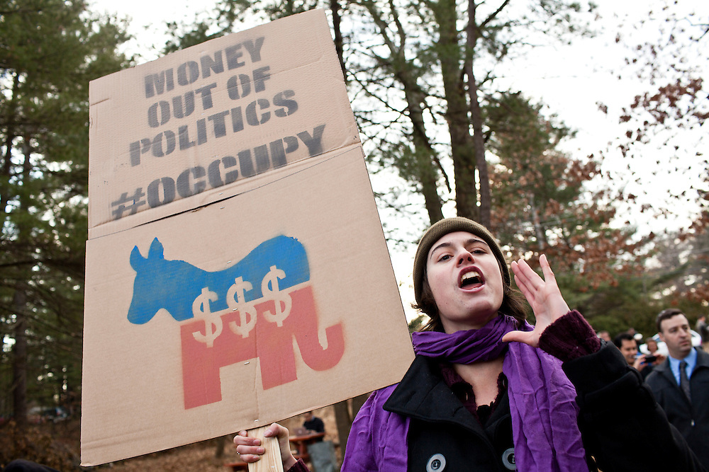 Susan Hutchings yells during an Occupy movement protest against Republican presidential candidate Rick Santorum after a meet and greet at Homestead Grocery and Deli on Saturday, January 7, 2012 in Amherst, NH. Brendan Hoffman for the New York Times