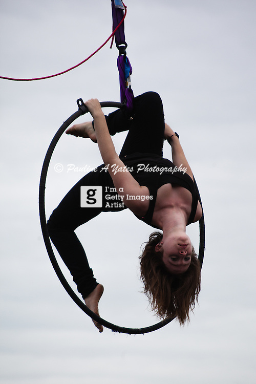 A Trapeze artist at Strawberry Fair, Cambridge practicing before her show.