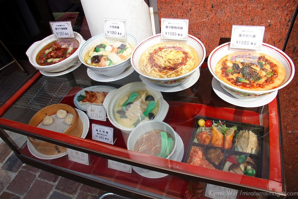 Asia, Japan, Tokyo. Display of food and dishes available outside of a Tokyo restaurant.