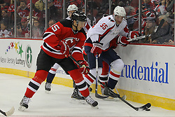 Jan 25, 2013; Newark, NJ, USA; New Jersey Devils center Stefan Matteau (15) skates with the puck past Washington Capitals defenseman Jeff Schultz (55) during the first period at the Prudential Center.