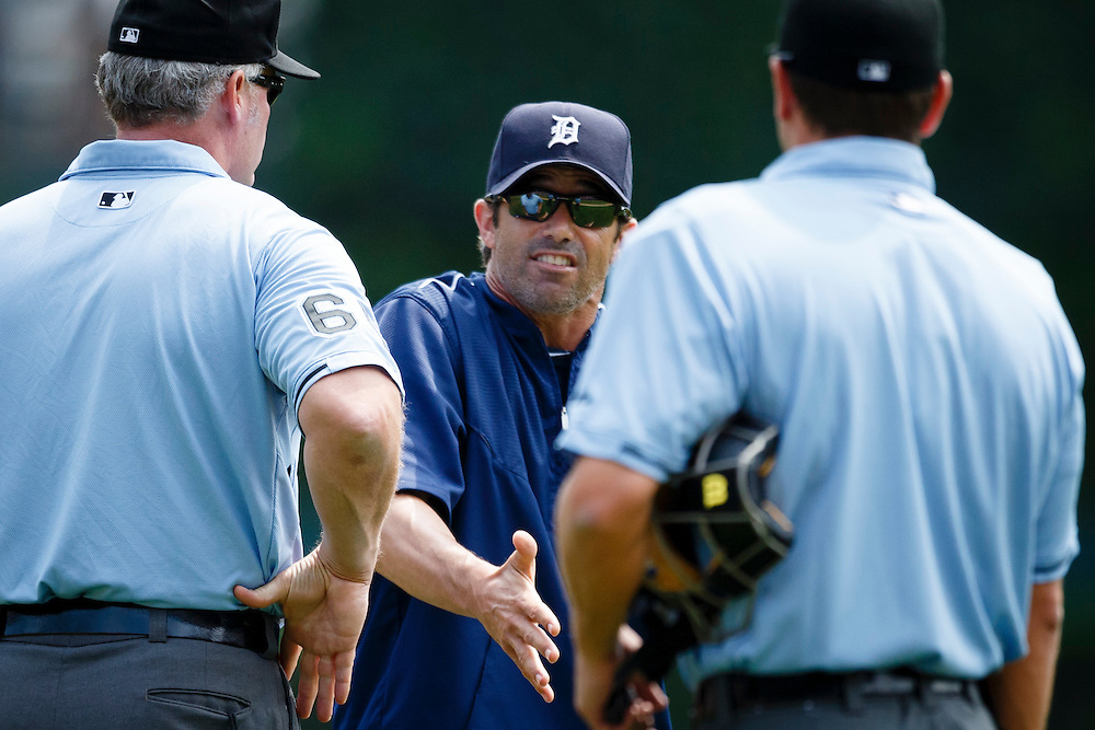 Aug 9, 2015; Detroit, MI, USA; Detroit Tigers manager Brad Ausmus (7) argues a call with umpires Ted Barrett (left) and Ben May (right) in the first inning against the Boston Red Sox at Comerica Park. Mandatory Credit: Rick Osentoski-USA TODAY Sports