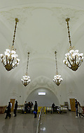Huge foyer with enormous chandeliers in Moscow Metro