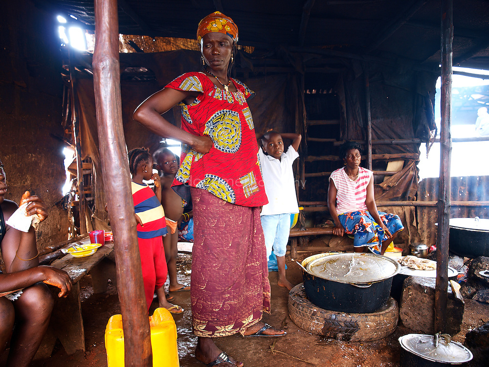 Rachel runs a ?restaurant? in Kroo Bay. The rising food prices have had an impact on her business. She is serving smaller plates of rice now to cover the rising costs she pays for rice, Kroo Bay, Freetown, Sierra Leone.