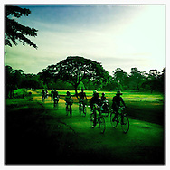 (SIEM REAP, CAMBODIA - MAY 29, 2012)<br /> Commuters ride bicycle at Angkor Tom temple complex in Siem Reap, Cambodia on May 29 2012. After 25 year of isolation, Cambodia opened to tourists in the mid-1990s and tourist&rsquo;s numbers have increased every year since - the country seeing more than a million tourists in 2011.<br /> (Photo by Kuni Takahashi)
