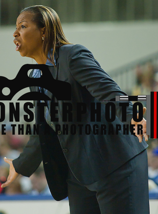 01/12/12 Newark DE: University of North Carolina Wilmington Women's Head Coach Cynthia Cooper-Dyke yells out of frustration from the sidelines during a Colonial Athletic Association Conference Basketball Game against Delaware Thursday, Jan. 12, 2012 at the Bob Carpenter Center in Newark Delaware.<br /> <br /> No. 18 Delaware (13-1, 4-0) defeated University of North Carolina Wilmington (8-7, 1-3) 69-37 continuing their best start in school history behind Elena Delle Donne 23 point scoring point effort.