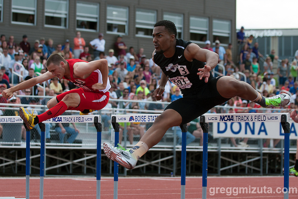 Rocky Mountain senior Khalil Oliver and Boise senior Peyton Harris in heat 1, 110 meter hurdles during the Idaho 5A State Track & Field Championships at Dona Larsen Park, Boise, Idaho on May 16, 2014. Oliver posted a 14.64 and Harris 14.70. Both qualified for the finals.