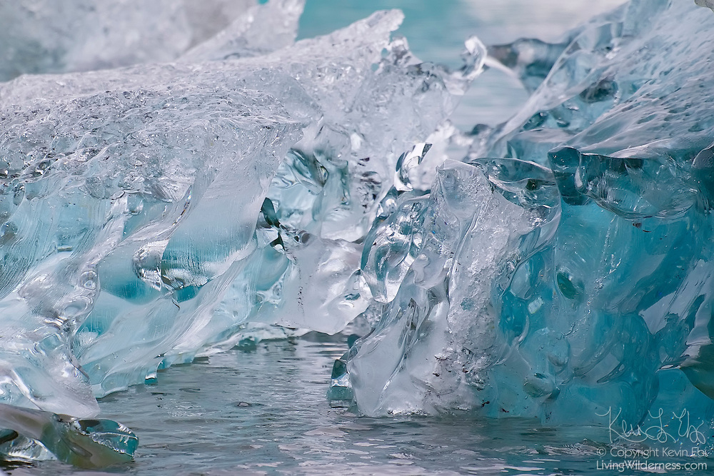 A glassy iceberg comprised of ice believed to be more than 1,500 years old floats in Jökulsárlón, the glacier lagoon in southern Iceland. The oldest ice in the lagoon is almost like glass. Over time, the weight of ice and snow on top of it presses out any air. Without the obstruction of air pockets, blue wavelengths of light are able to penetrate deep into the iceberg, resulting in the blue color.