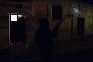 Members of the Free Syrian Army patrol and guard against sniper attacks at night, Al Janoudiyah, Syria