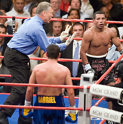 May 6, 2006 - Las Vegas, NV - Oscar DeLaHoya looks on as referee Jay Nady administers the count to Ricardo Mayorga in the 6th round of their 12 round fight for the WBC Super Welterweight Championship at the MGM Grand Garden Arena.  DeLaHoya captured the title via 6th round TKO.
