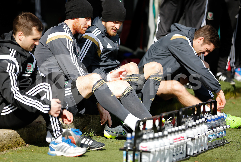 Players including James Collins (second left) and Aaron Ramsey (second right) prepare for Wales National Team in Training at The Vale Resort, Hensol, Wales on 25 March 2015. Photo by Mark Hawkins.