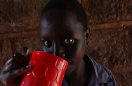 Young Kenyan resident of the Huruma Children's Home having lunch in Nyeri, Kenya on Sunday, May 7, 2006.