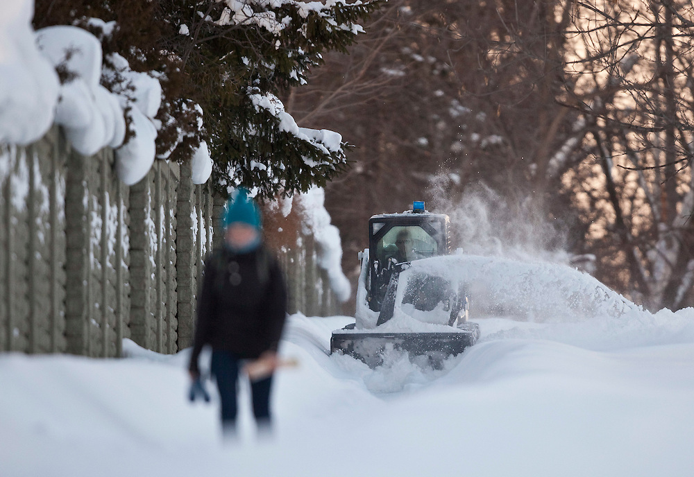 A University of Western Ontario student walks along a snow covered sidewalk in London, Ontario December 8, 2010. The region has been pummelled by snow squalls for 3 days with some areas receiving over 1.5 metres of snow causing the university to cancel classes.<br /> The Canadian Press/GEOFF ROBINS