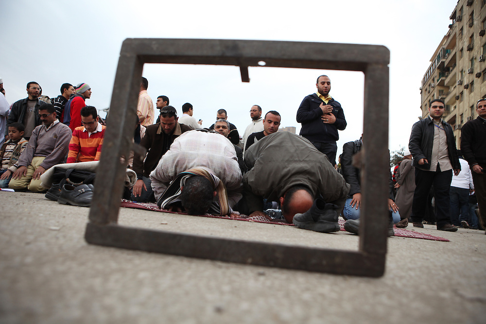 """Egyptian Muslims pray on """"Sunday of the martyrs"""" at Tahrir Square."""