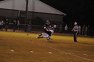 Water Valley's Chris Conard (7) makes a tackle vs. Mooreville in Mooreville, Miss. on Friday, September 30, 2011. Water Valley won 21-20 in overtime.