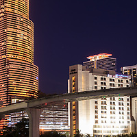 Miami Metromover automated rail car station and viaduct over the Miami River at night, with the Miami Tower in the background. WATERMARKS WILL NOT APPEAR ON PRINTS OR LICENSED IMAGES.
