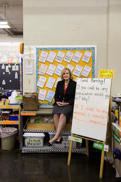 Philadelphia, Pennsylvania - October 24, 2013:<br /> <br /> AARP Experience Corps Branch Director Catherine Mesaros sits in Cramp Elementary School first grade teacher Delilah Montemayor's classroom.